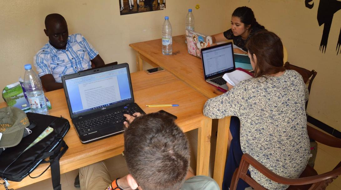 Students work in the office during their Human Rights internship in Senegal.